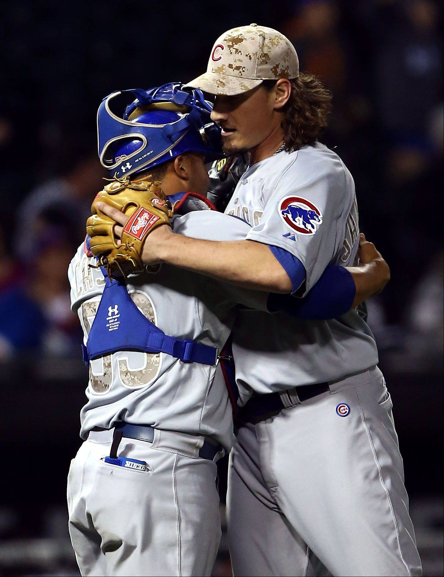 Cubs pitcher Jeff Samardzija hugs catcher Welington Castillo after pitching a complete-game 2-hitter as the Cubs beat the White Sox 7-0 Monday night at U.S. Cellular Field.