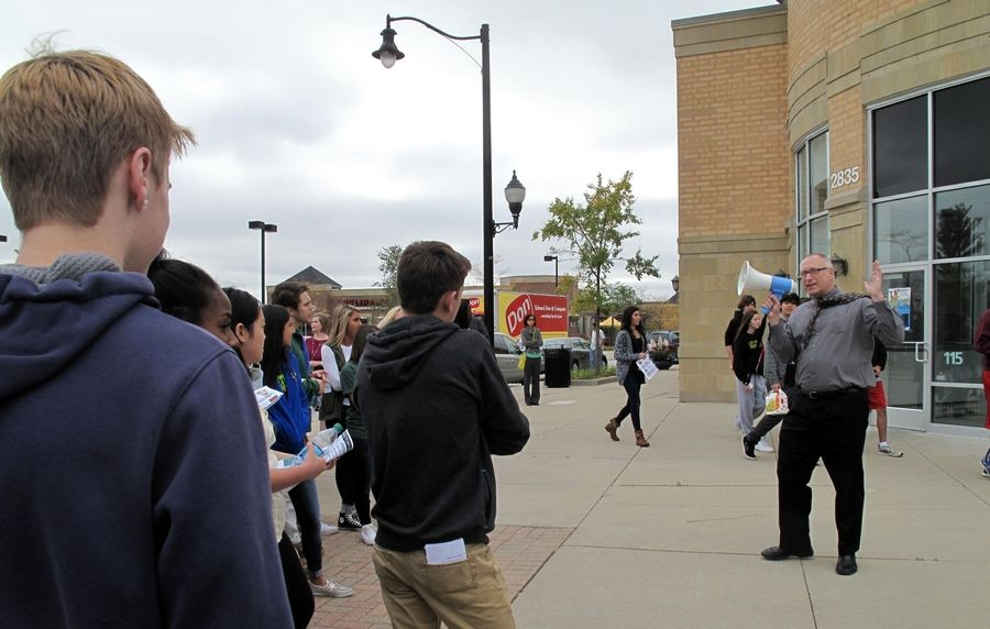 Naperville City Council member Robert Fieseler introduces Waubonsie Valley High School students to their new marketing challenge: Promote vacant storefronts and land in the Naperville Crossings development at Route 59 and 95th Street to new businesses.