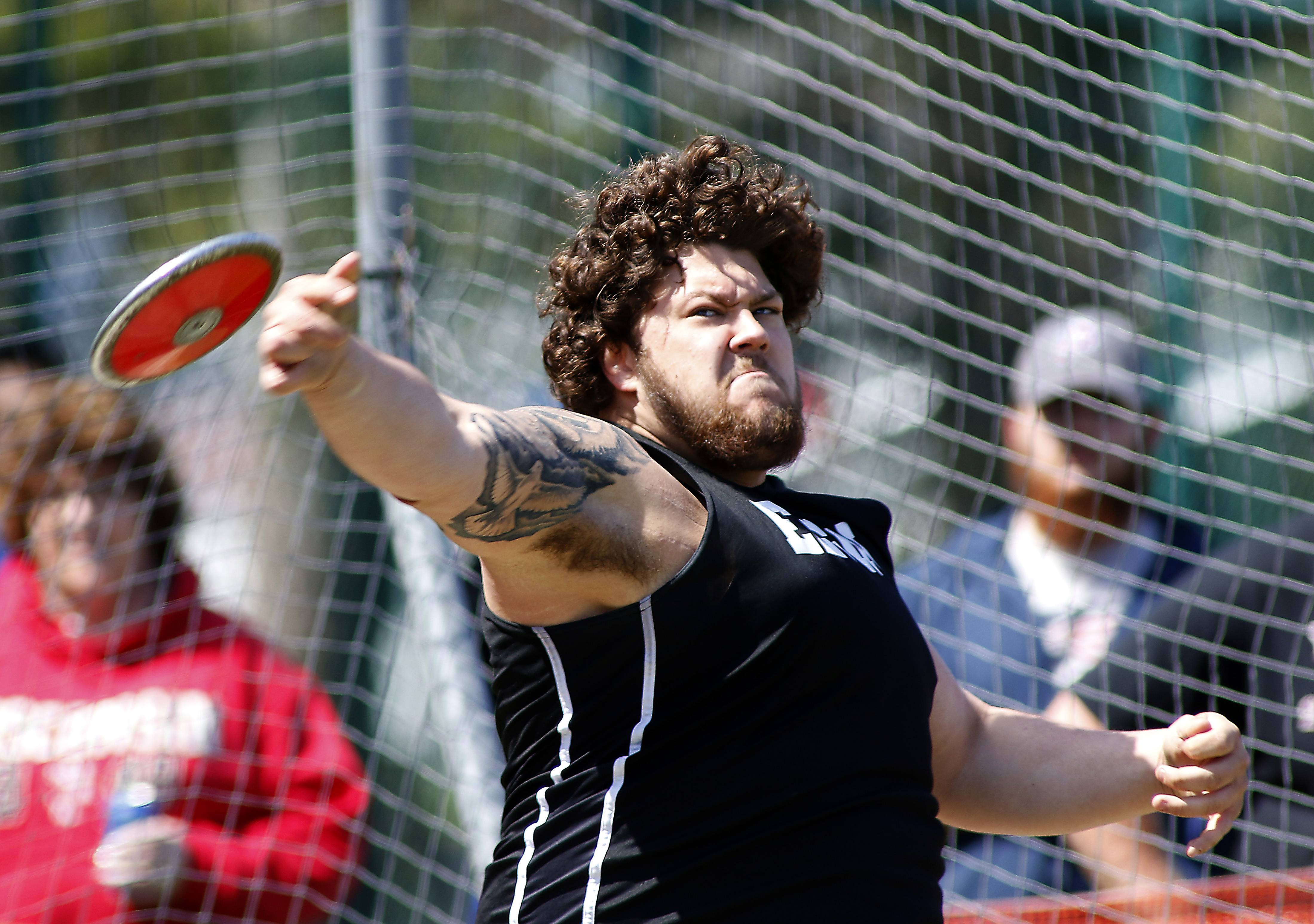 Fernando Vargas of Elgin throws the discus Saturday during the 45th Annual Peterson Prep Invitational at Kaneland High School in Maple Park.