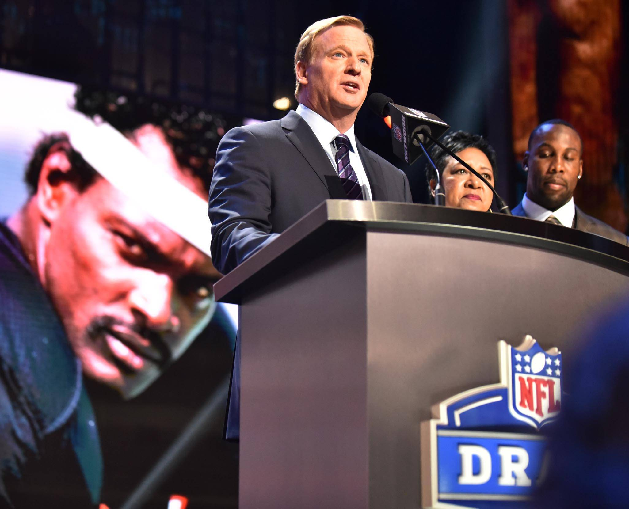 NFL Commissioner Roger Goodell and Connie Payton, wife of Chicago Bears legend Walter Payton, appear with Walter Payton Award winner Anquan Bodin Thursday at the 2016 NFL draft.