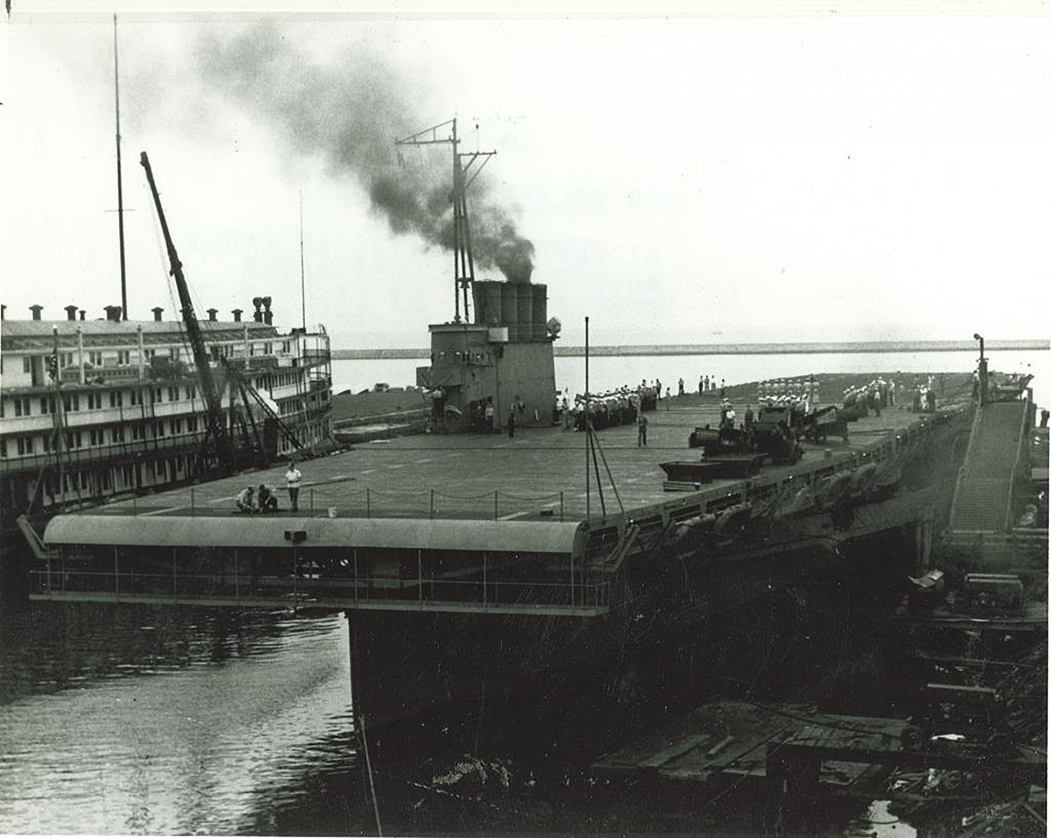As its sister passenger ship, left, waits for its makeover, a former Great Lakes tourist ship is ready to serve as a makeshift aircraft carrier. The two ships were used to train 15,000 pilots and 40,000 crew members in Lake Michigan during World War II.