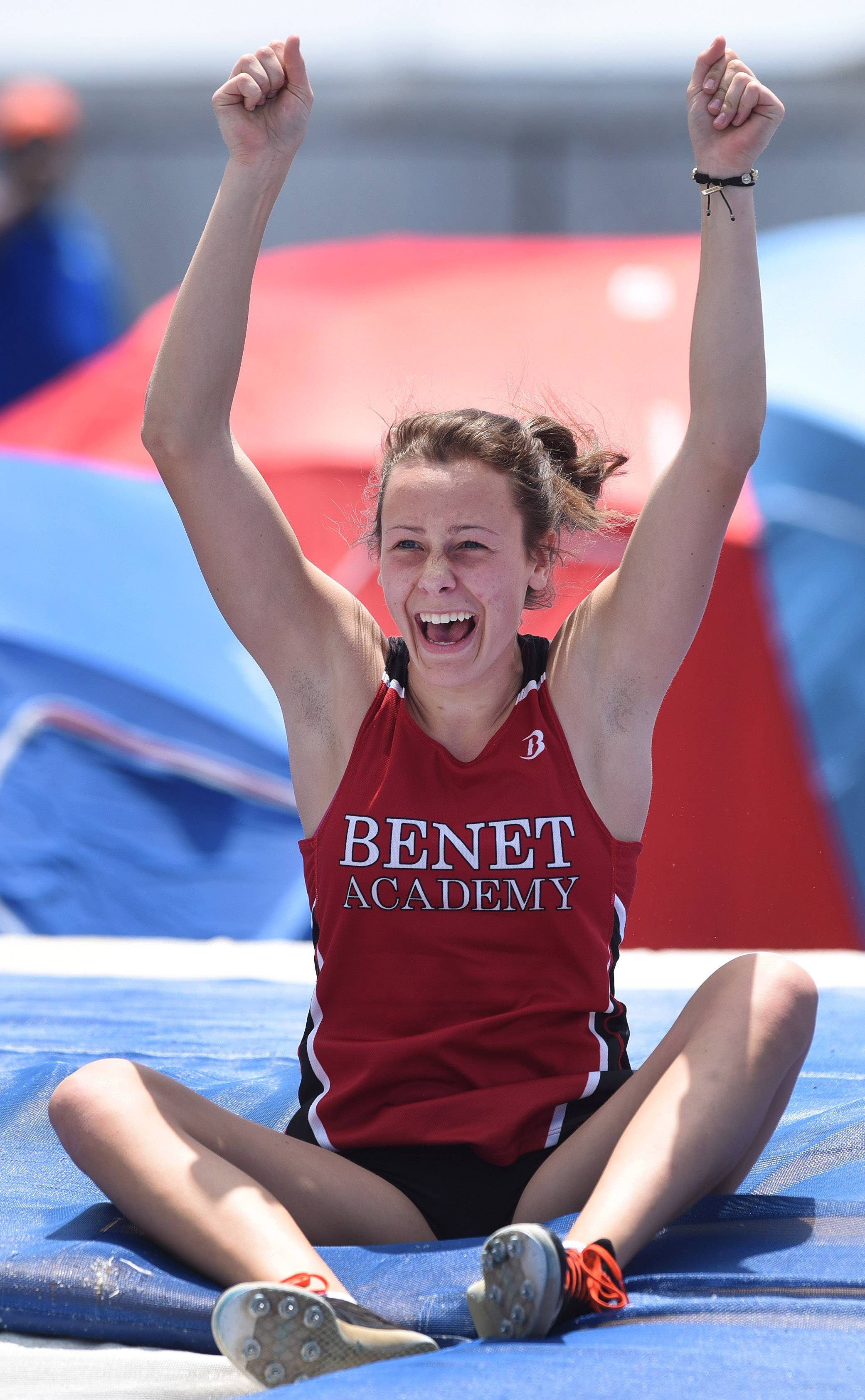 Ali Munson of Benet Academy celebrates as she wins the Class 2A state title in pole vault during the IHSA girls state track finals in Charleston Saturday