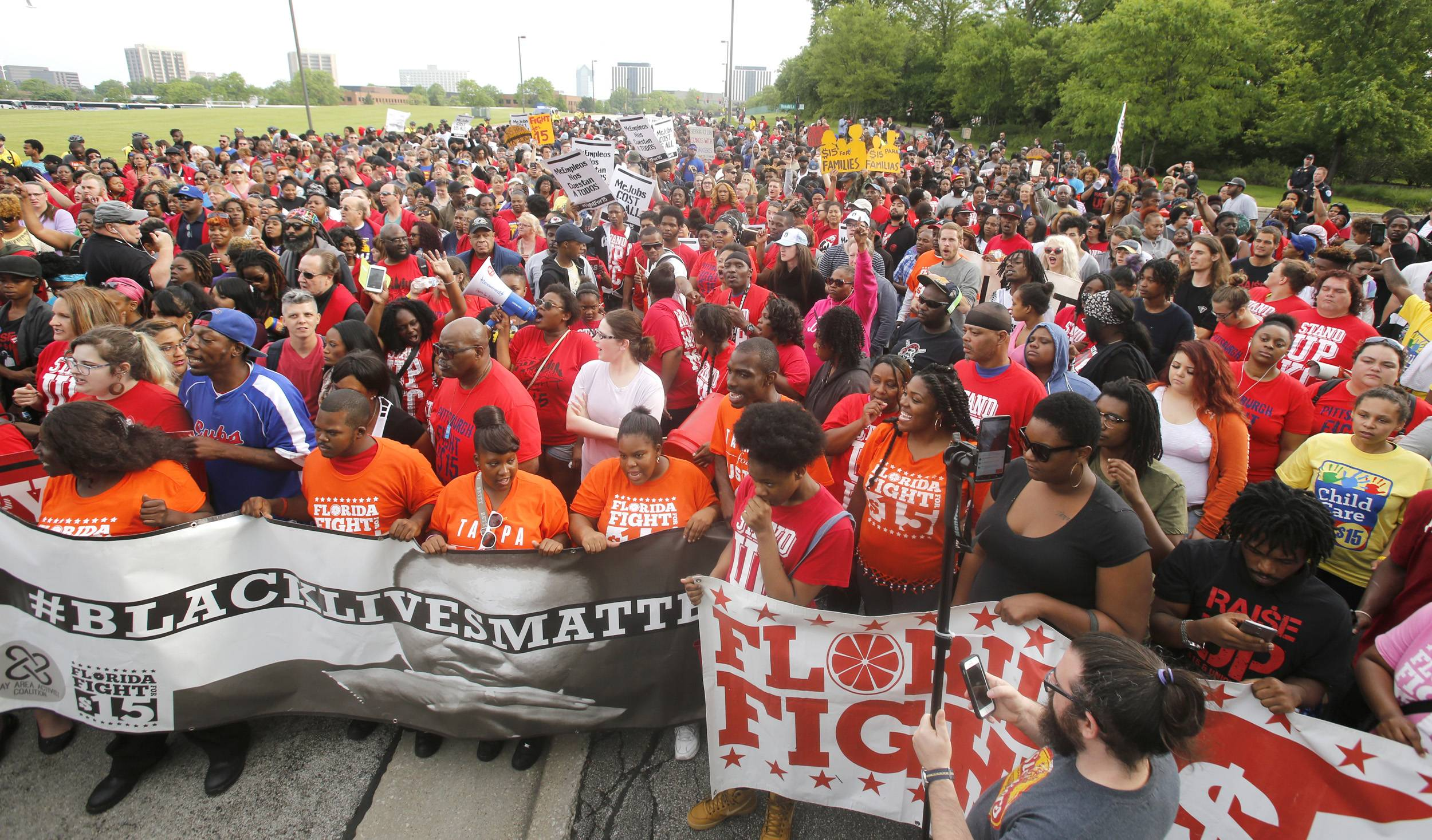 Hundreds of McDonald's workers march outside the fast food chain's Oak Brook campus Thursday morning, kicking off their second day of protests over wages.