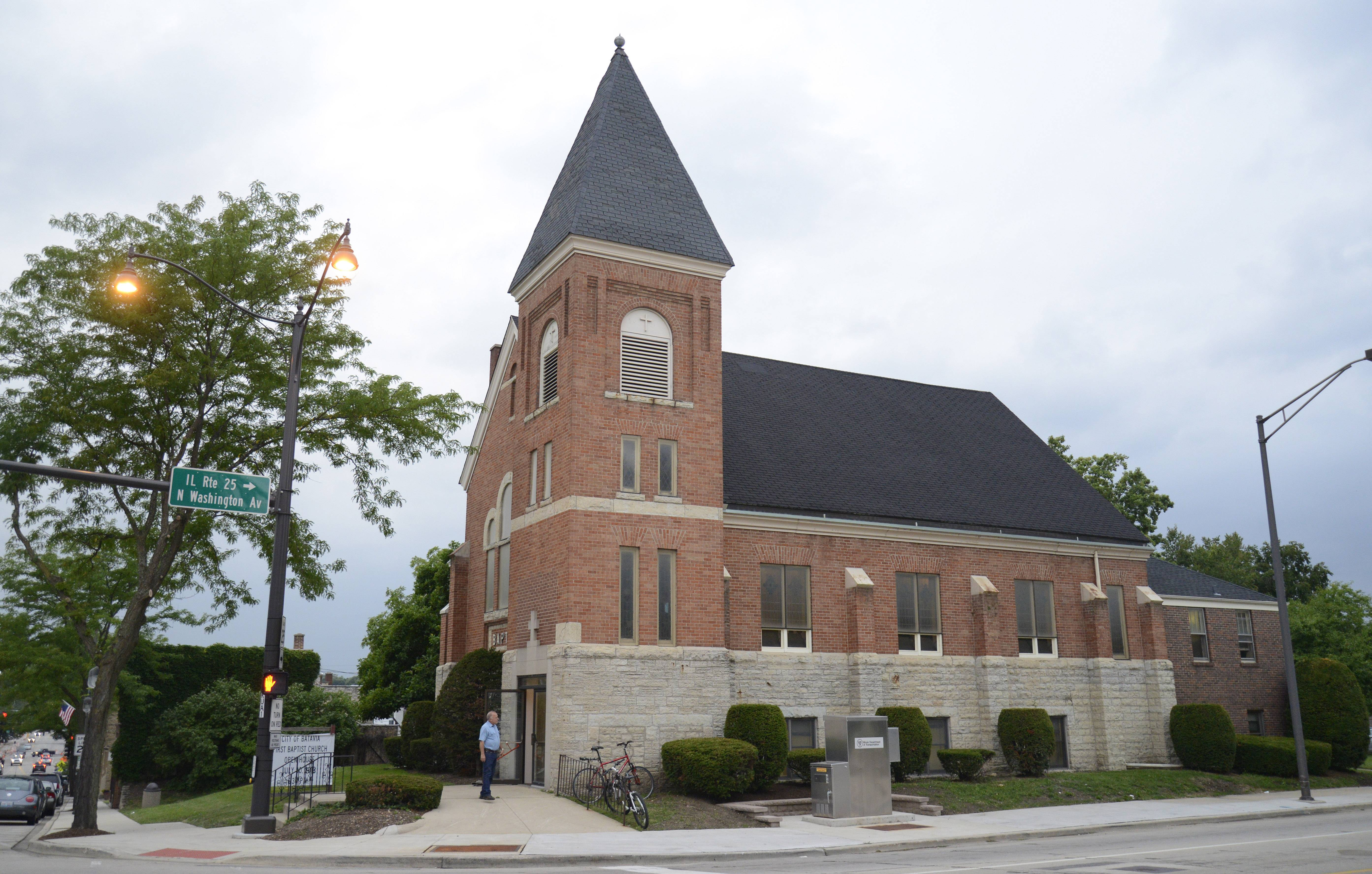 The former First Baptist Church in Batavia would be torn down as part of a plan to build apartments, a parking garage and stores at Wilson Street and Washington Avenue.