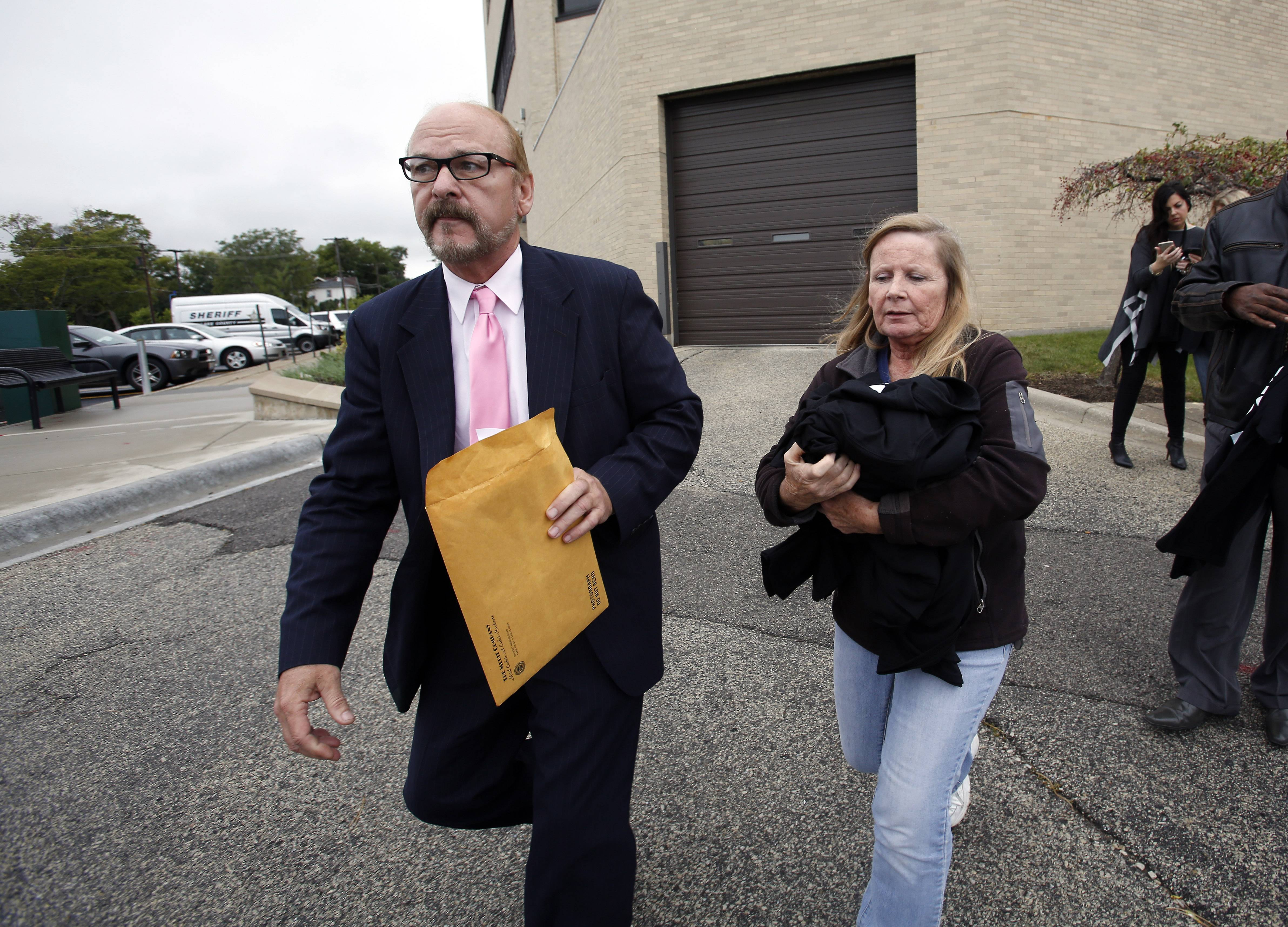 Paul and Cheryl Calusinski leave Lake County court after a judge refused to grant a new trial for their daughter Melissa Calusinski.
