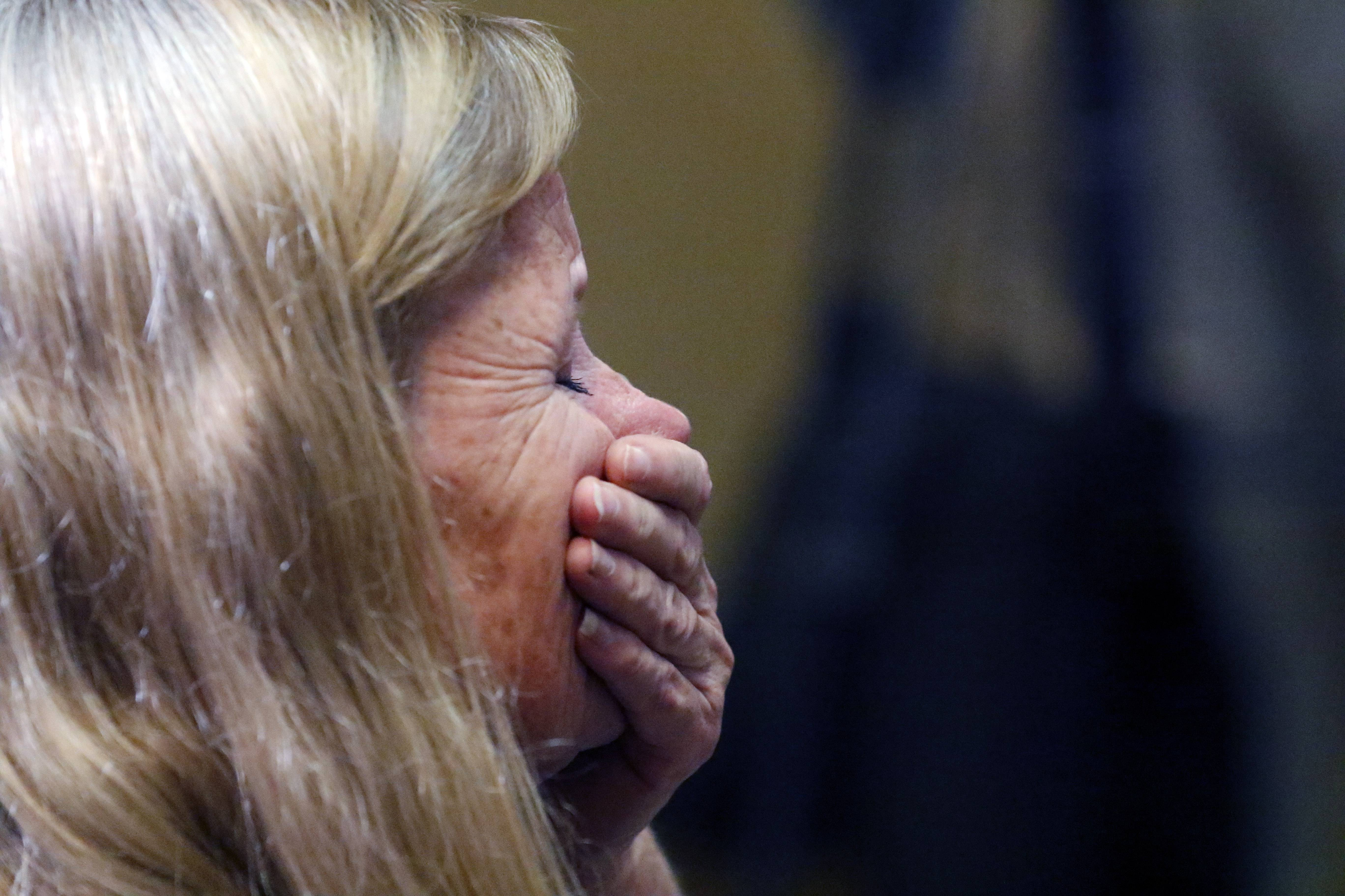Cheryl Calusinski reacts during a Friday news conference after a Lake County judge refused to grant a new trial to her daughter Melissa Calusinski in the murder of a toddler at Lincolnshire day care center.