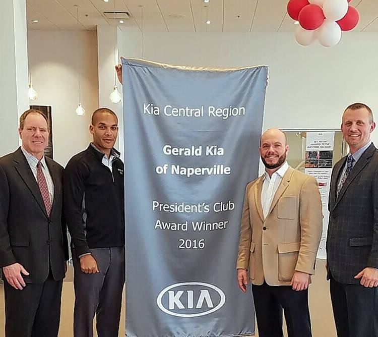 From left, Michael Dagnon, Anthony Triner, Doug Gerald and Nathan Rachow celebrate Gerald Kia of Naperville being named to Kia's Presiedent's Club.