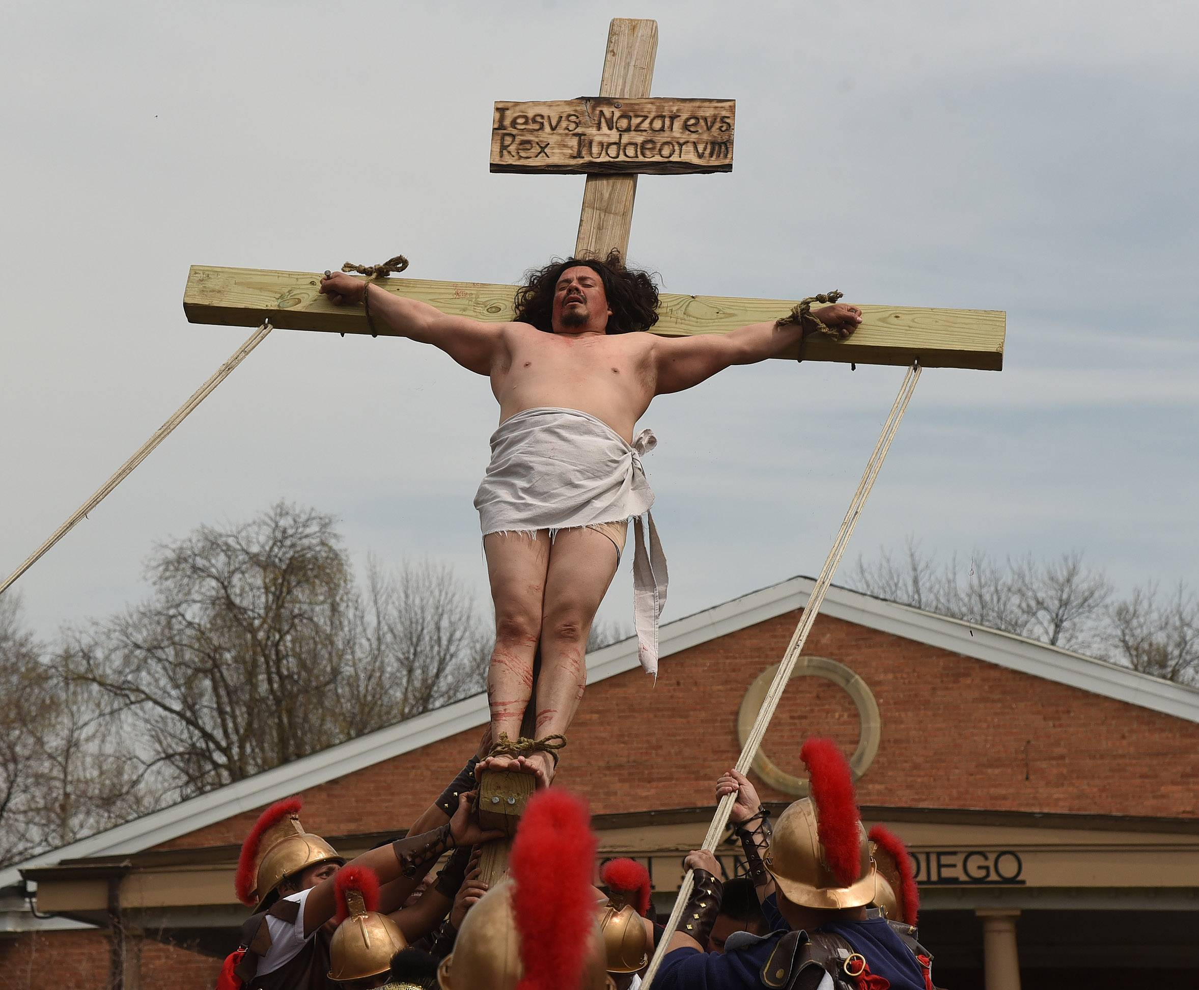 Jesus, played by Adan Cervantes, is crucified during the annual Living Stations of the Cross procession from St. Thomas of Villanova in Palatine to Mision San Juan Diego in Arlington Heights on Good Friday.