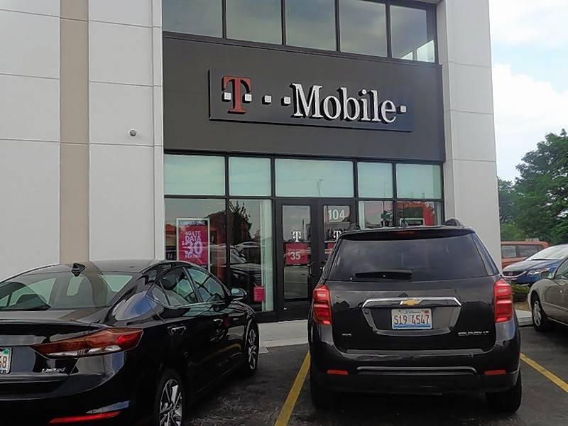 T-Mobile said Wednesday it will open 40 more stores in Chicago and the suburbs. This one is in Vernon Hills, which opened in late March.