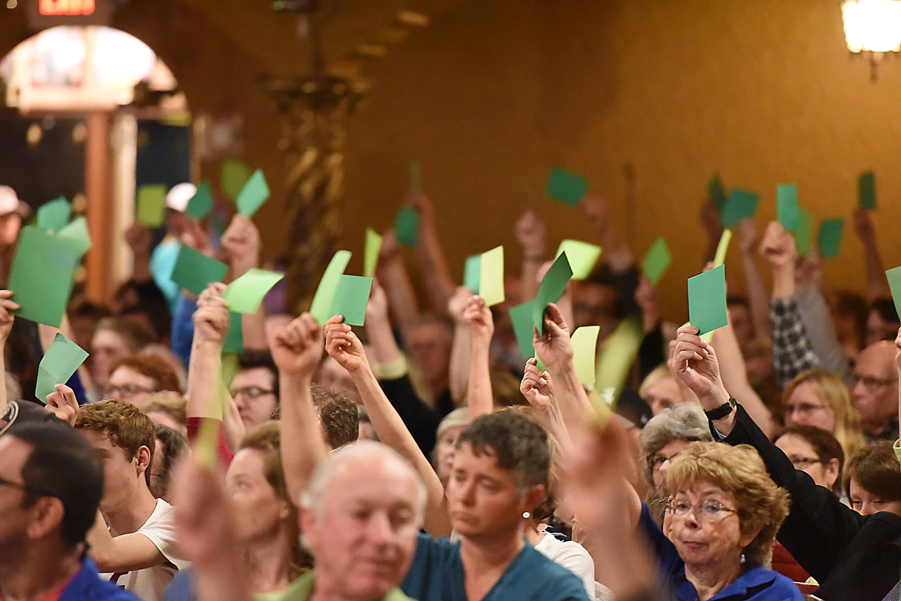 People held red or green cards to express agreement or disagreement with Congressman Randy Hultgren at a town hall forum Tuesday in St. Charles.