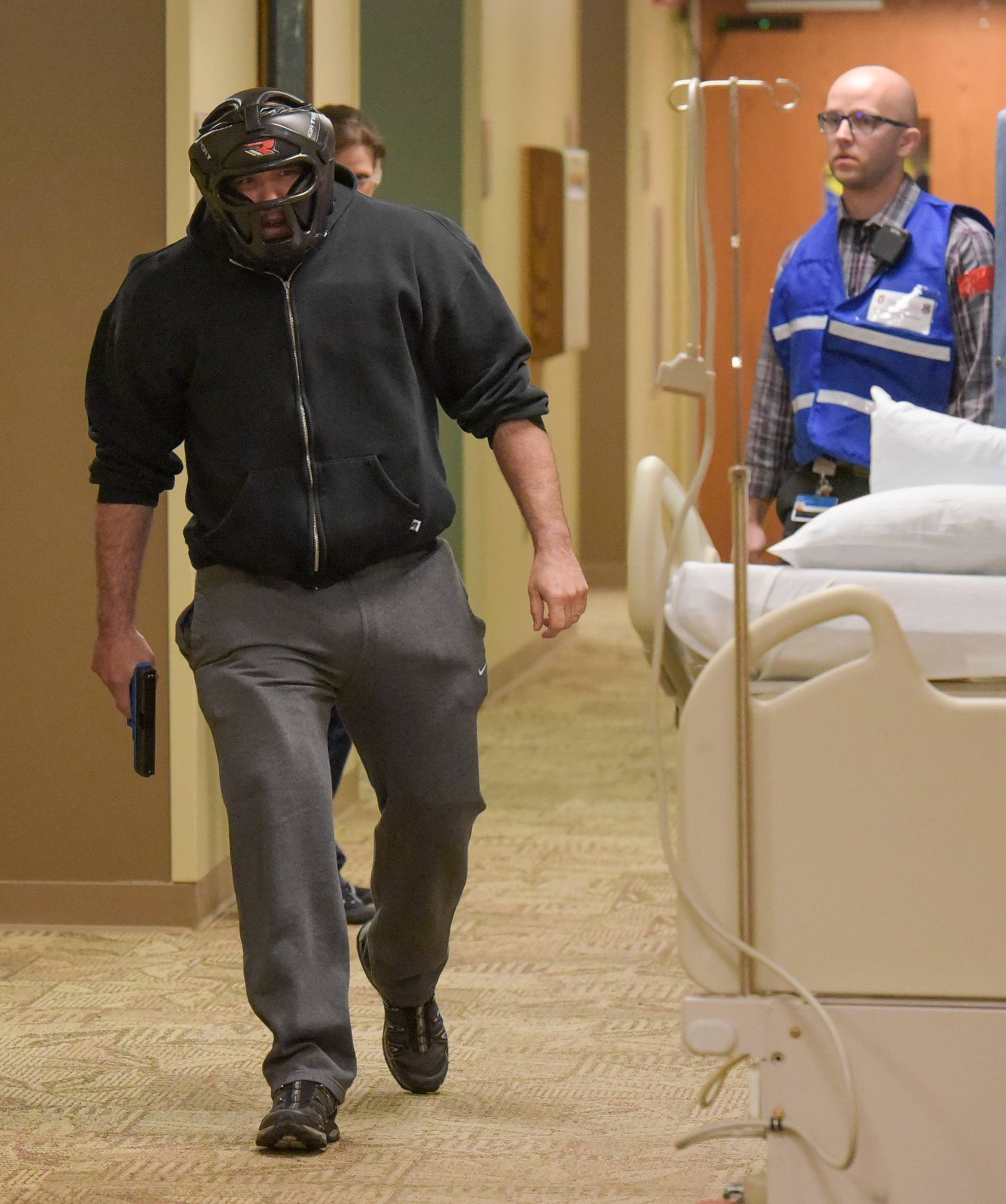 During an active shooter drill Thursday morning at Edward Hospital, a Naperville police SWAT officer playing the shooter makes his entrance into a unit on the first floor, seeking the doctor who had given him bad news about his father's prognosis.