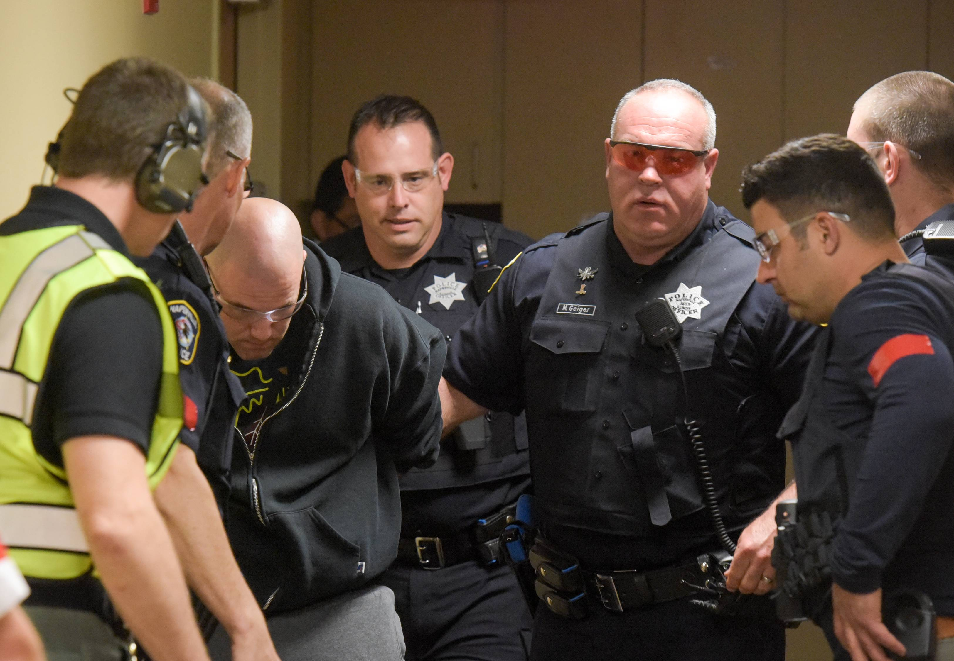 Naperville police conducting an active shooter drill take the suspect into custody Thursday morning at Edward Hospital.