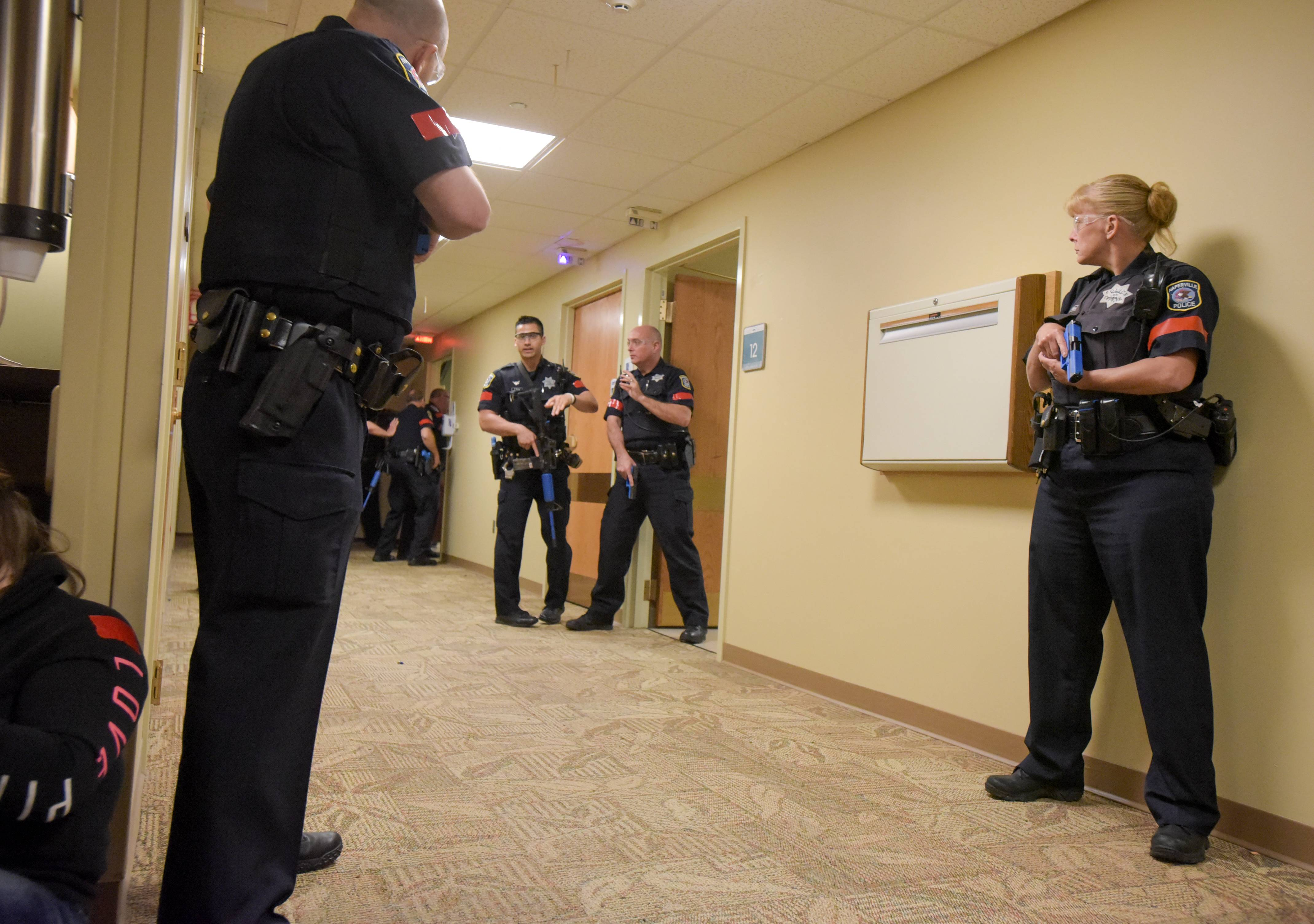 Naperville police officers secure a hallway Thursday morning during an active shooter drill at Edward Hospital.