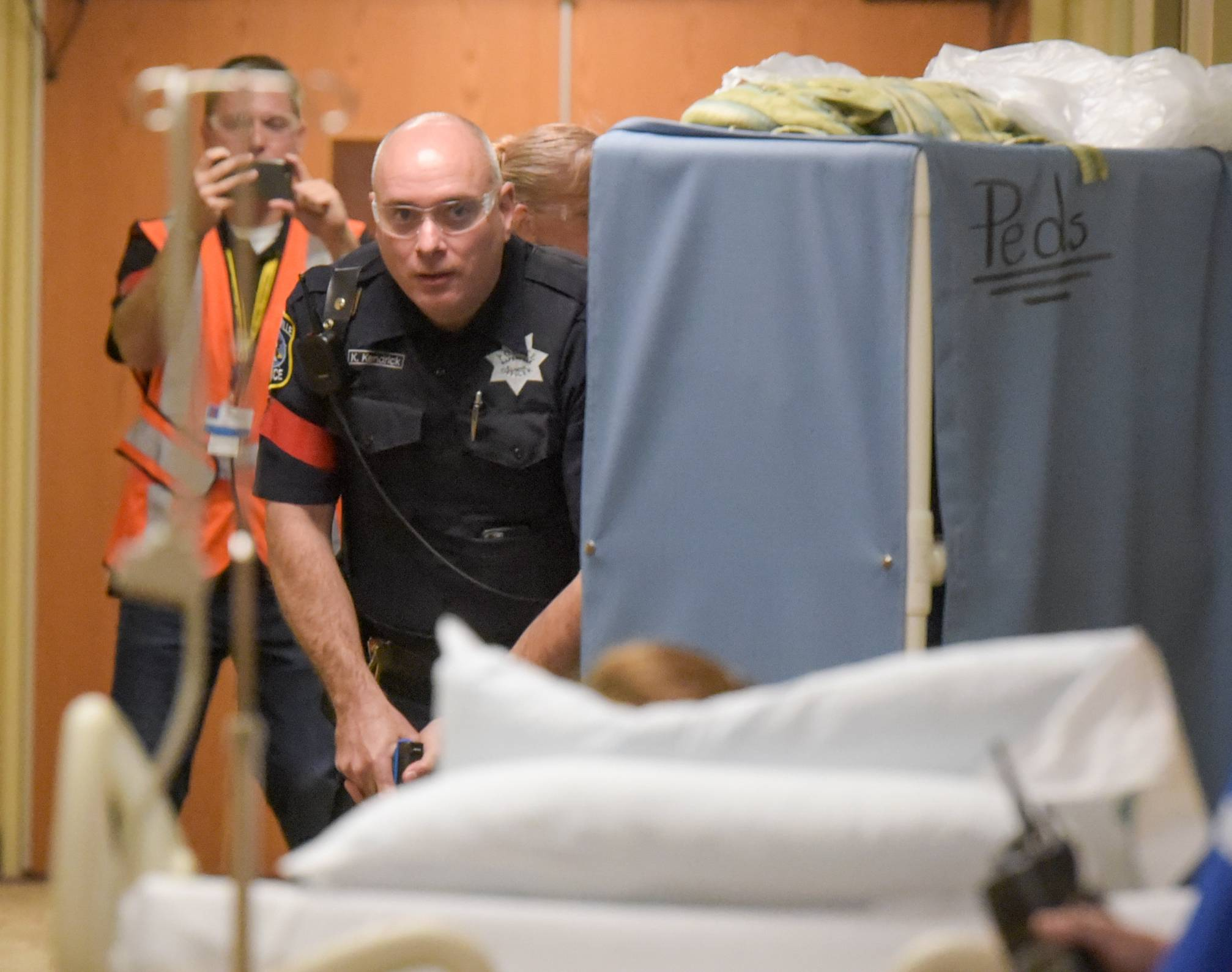 During the drill, Naperville officers work their way down a hallway at Edward Hospital, searching for a man who had fired several shots after becoming enraged at a doctor.