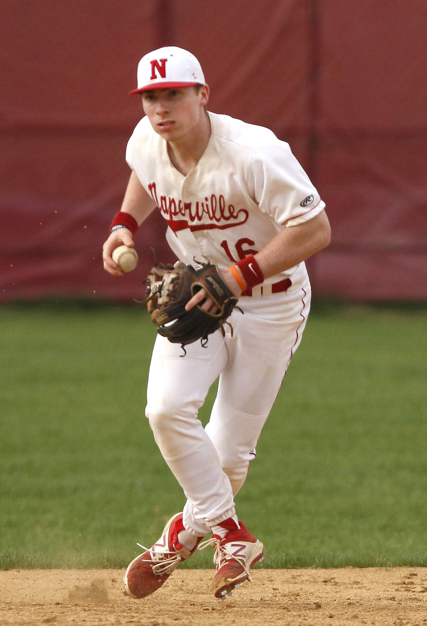 Naperville Central's Connor Gurnik fields a ground ball during a 5-3 win over Waubonsie Valley in Naperville.