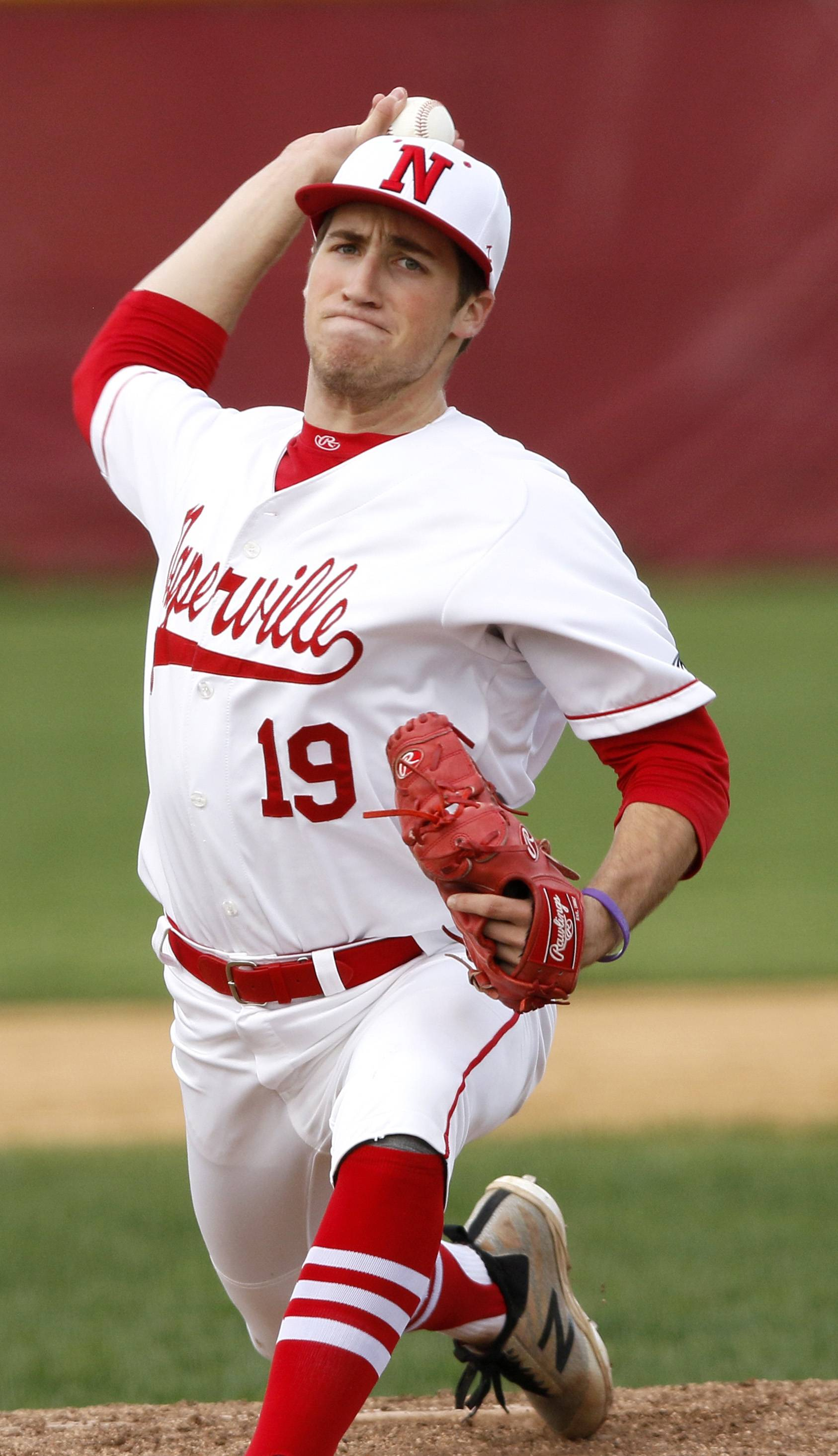 Naperville Central's Tyler Brinker delivers a pitch against Waubonsie Valley during a 5-3 win in Naperville.