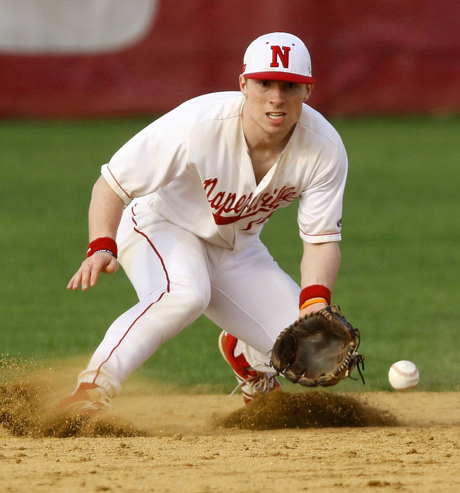 Naperville Central' shortstop Connor Gurnik fields a ground ball during a 5-3 win over Waubonsie Valley in Naperville.