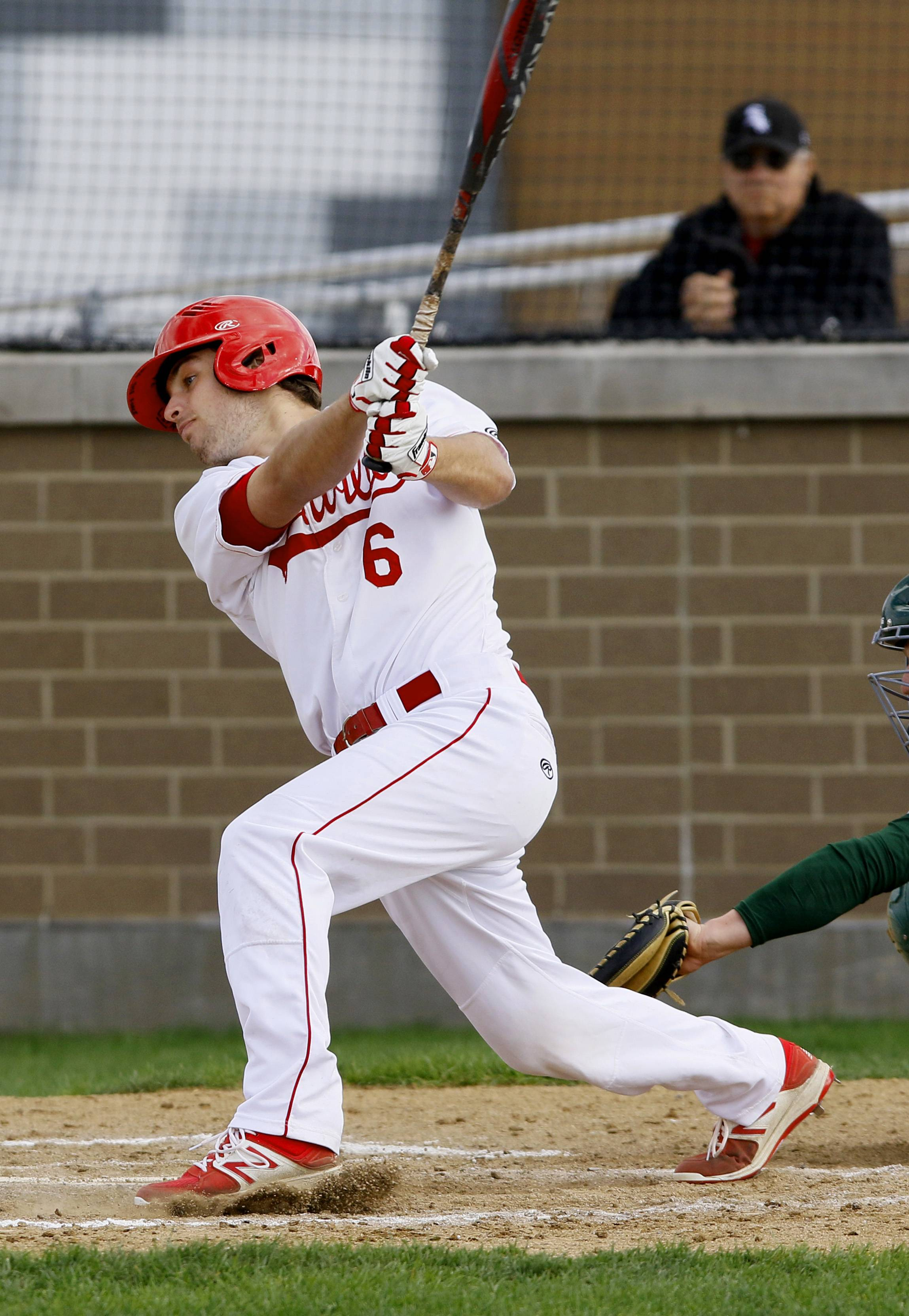 Naperville Central's Thomas Carlsen battles Waubonsie Valley during boys baseball action in Naperville.