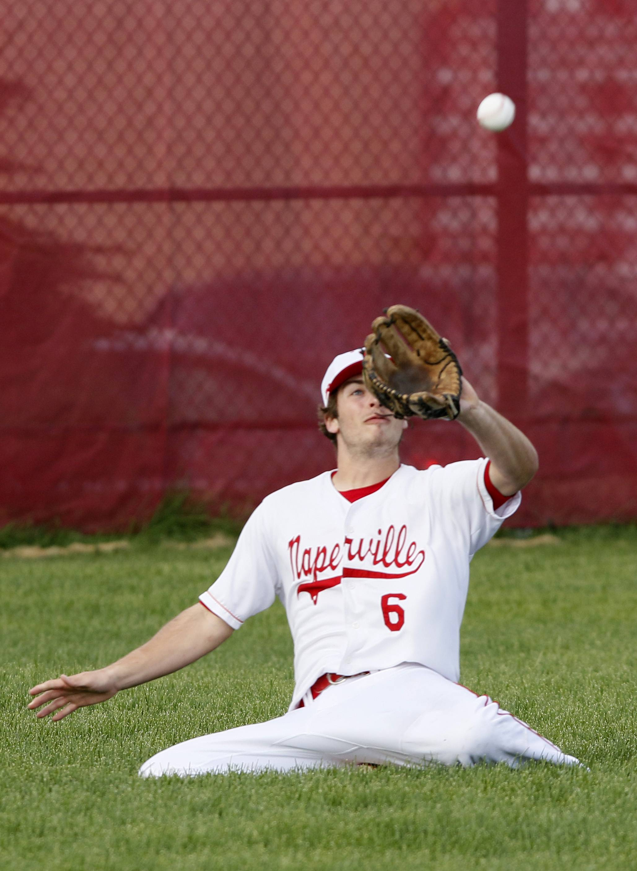Naperville Central's Thomas Carlsen eyes the ball against Waubonsie Valley during boys baseball action in Naperville.