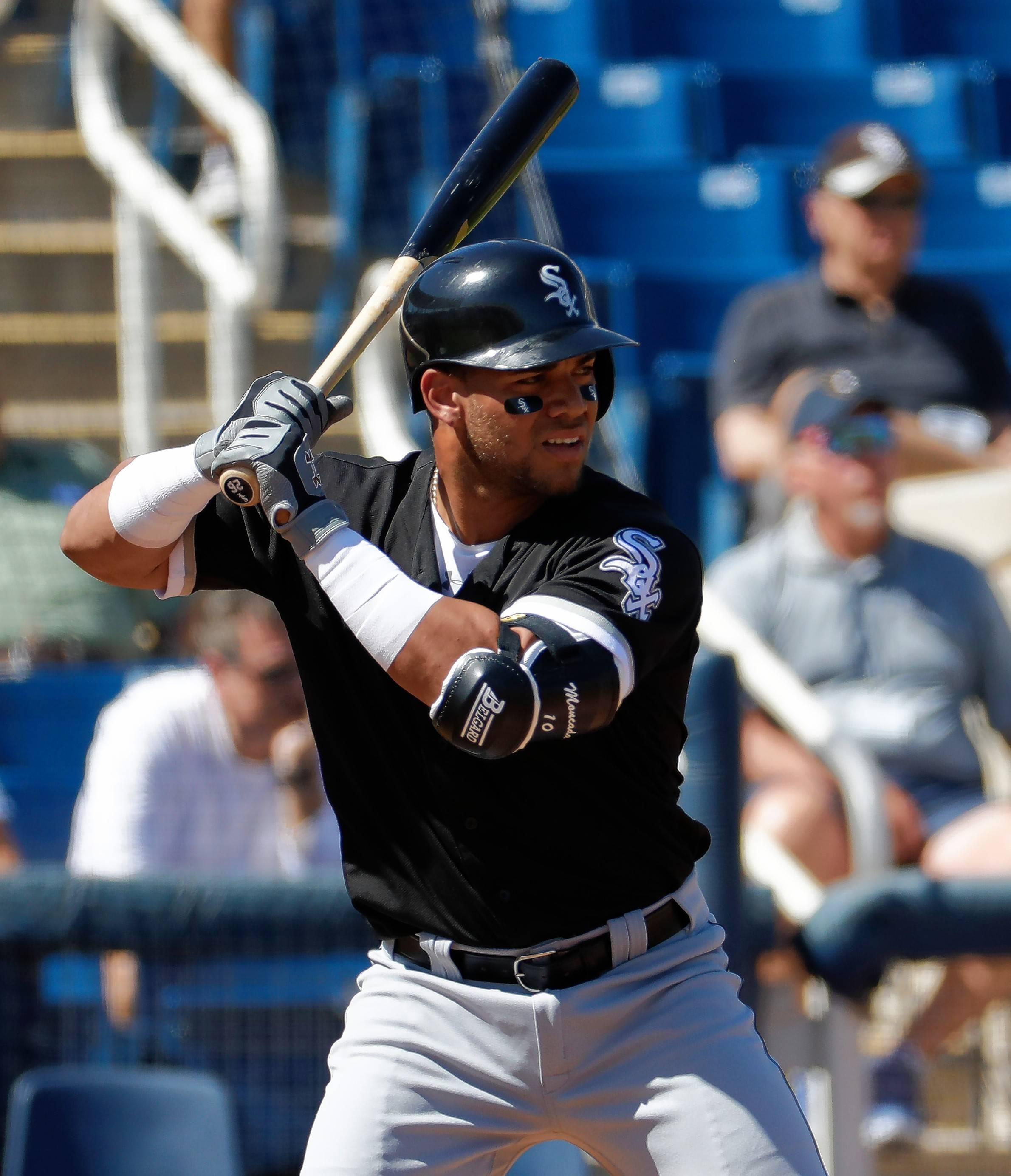 Chicago White Sox second baseman Yoan Moncada hits against the Milwaukee Brewers during the second inning of a spring training baseball game, Friday, March 10, 2017, in Phoenix.