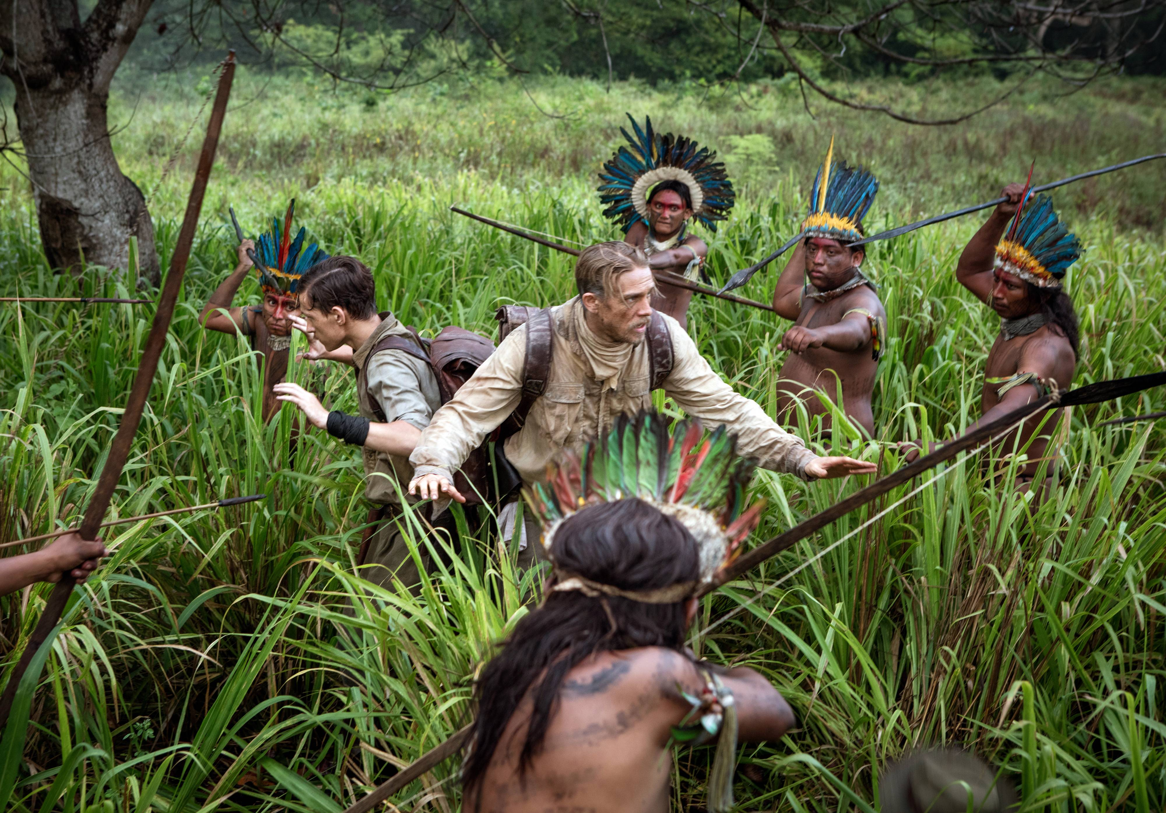 "A British explorer (Charlie Hunnam) and his son (Tom Holland) fall into a dangerous jungle situation in ""The Lost City of Z."""