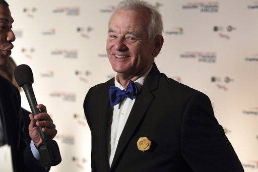 FILE - In this Oct. 23, 2016, file photo, Bill Murray arrives at the Kennedy Center for the Performing Arts for the 19th Annual Mark Twain Prize for American Humor presented to Bill Murray in Washington. The New York Times reported on April 19, 2017, that Murray is set to go on tour with a chamber music trio for a program of songs and literary readings.(Photo by Owen Sweeney/Invision/AP, File)