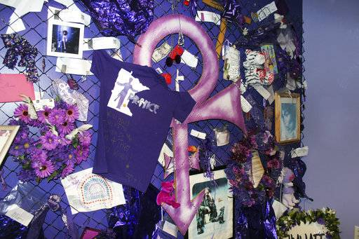"FILE In this Nov. 2, 2016 file photo, a replica of the Memorial Fence is shown at Prince's Paisley Park in Chanhassen, Minn. Paisley Park, home and studio of the late musician Prince, is open for public tours. At his home and recording studio-turned-museum, a full four days of events are on tap for the one-year anniversary of his death on April 21, 2016, ranging from concert performances by the great one's former band mates to panel discussions on his legacy. Fans who can't afford those high-dollar tickets can head to a street party outside the club he made famous in ""Purple Rain."""