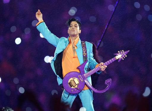 FILE - In this Feb. 4, 2007, file photo, Prince performs during the halftime show at the Super Bowl XLI NFL football game at Dolphin Stadium in Miami. Prince died at his home in Chanhassen, Minn. on April 21, 2016 at the age of 57.