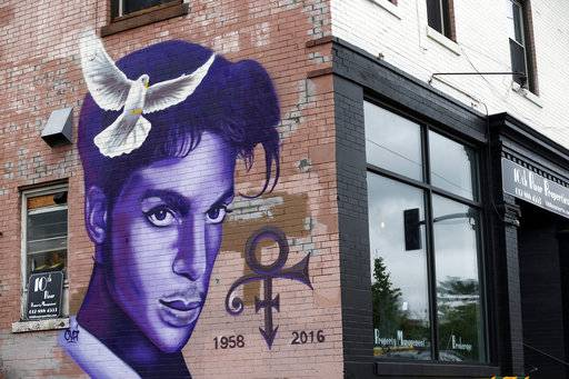 "FILE - In this Aug 28, 2016, file photo, a mural honoring the late Prince adorns a building in the Uptown area of Minneapolis. In addition, at his home and recording studio-turned-museum, a full four days of events are on tap for the one-year anniversary of his death on April 21, 2016, ranging from concert performances by the great one's former band mates to panel discussions on his legacy. Fans who can't afford those high-dollar tickets can head to a street party outside the club he made famous in ""Purple Rain."""
