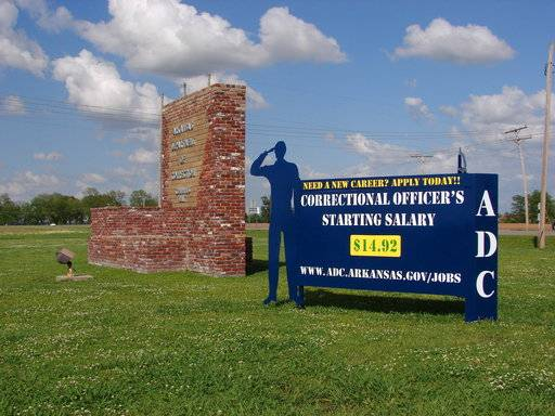 A recruiting sign for the Arkansas Department of Correction greets visitors to the Cummins Unit prison near Varner, Arkansas, which was scheduled to hold executions Thursday, April 20, 2017. If any inmate dies by lethal injection, it would be the state's first execution since 2005.