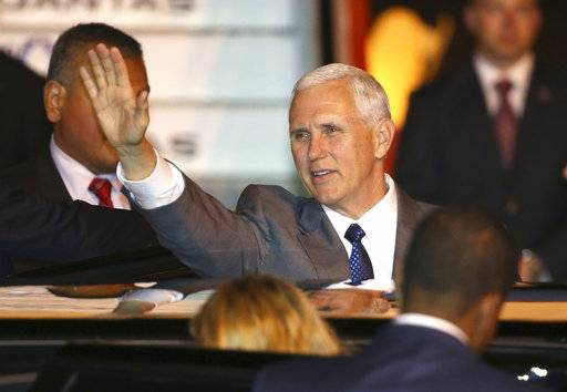 U.S. Vice President Mike Pence waves as he gets into his car after arriving in Sydney, Friday, April 21, 2017. Pence will meet with Australian Prime Minister Malcolm Turnbull on Saturday as part of his 10-day, four country trip to Asia. (AP Photo/Rick Rycroft)
