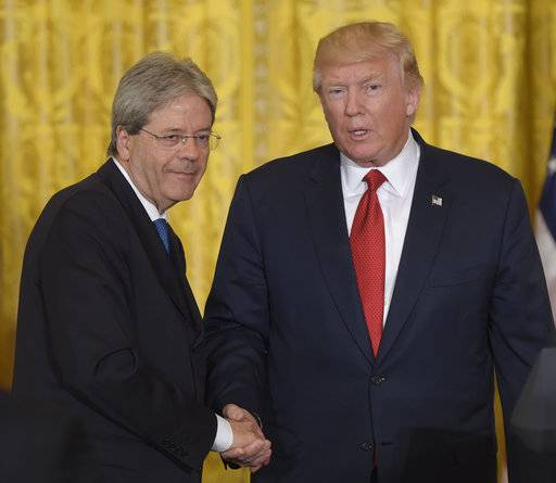 President Donald Trump, right, shakes hands with Italian Prime Minister Paolo Gentiloni, left, following their news conference in the East Room of the White House in Washington, Thursday, April 20, 2017.