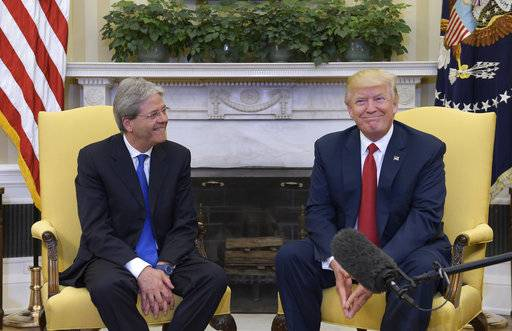 President Donald Trump meets with Italian Prime Minister Paolo Gentiloni in the Oval Office of the White House in Washington, Thursday, April 20, 2017.