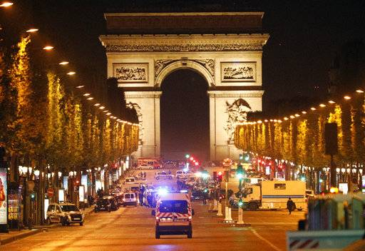 Police forces take positions on the Champs Elysees avenue in Paris, France, after a fatal shooting in which a police officer was killed along with an attacker, Thursday, April 20, 2017. An attacker with an automatic weapon opened fire on police on Paris' iconic Champs-Elysees Thursday night, killing one officer and seriously wounding two others before police shot and killed him.
