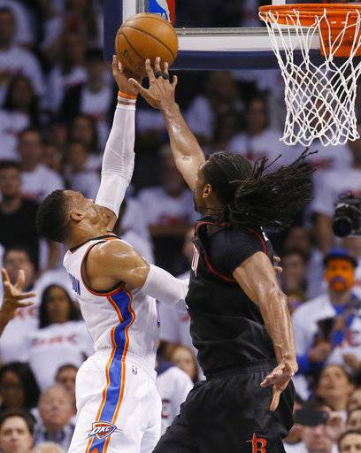 Oklahoma City Thunder guard Russell Westbrook, left, shoots as Houston Rockets center Nene, right, defends in the second quarter of a first-round NBA basketball playoff game in Oklahoma City, Friday, April 21, 2017. (AP Photo/Sue Ogrocki)
