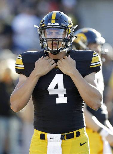 FILE - In this Sept. 10, 2016, file photo, Iowa quarterback Nathan Stanley warms up before an NCAA college football game against Iowa State in Iowa City, Iowa. Iowa opened spring practice hoping Stanley would seize the starting job. The Hawkeyes will open fall camp hoping for the same thing. (AP Photo/Charlie Neibergall, File)