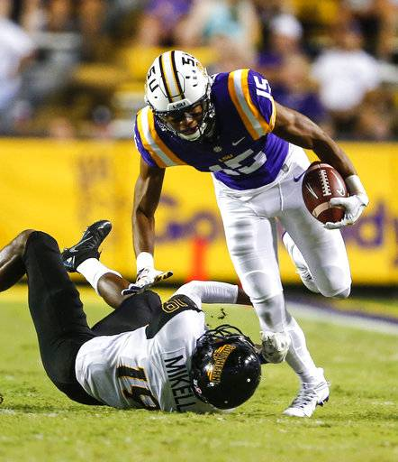 FILE - In this Oct. 15, 2016, file photo, LSU wide receiver Malachi Dupre (15) tries to break through the tackle of Southern Mississippi defensive back Curtis Mikell (19) during the second half of an NCAA college football game in Baton Rouge, La. Former college receivers Malachi Dupre of LSU and Travis Rudolph of Florida State are examples of pro prospects who left high school as elite national recruits and now enter the NFL draft trying to overcome a perceived lack of production in college. (AP Photo/Butch Dill, File)