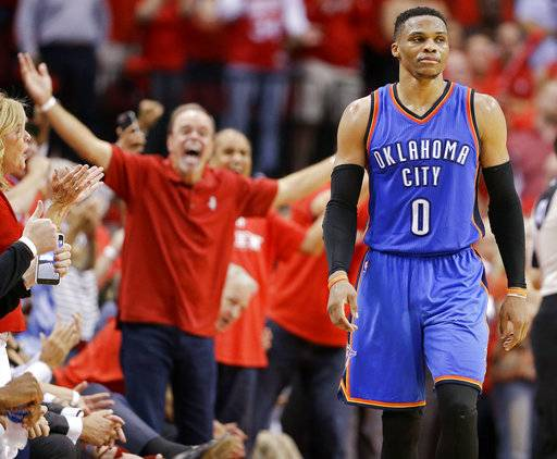 Oklahoma City Thunder guard Russell Westbrook walks down the court in the final seconds of Game 2 of the team's NBA basketball first-round playoff series against the Houston Rockets, Wednesday, April 19, 2017, in Houston. Houston won 115-111.