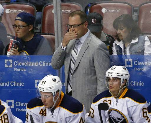 FILE - In this Oct. 15, 2015, file photo, Buffalo Sabres head coach Dan Bylsma looks on during the third period of an NHL hockey game against the Florida Panthers, in Sunrise, Fla.  The Buffalo Sabres have fired general manager Tim Murray and coach Dan Bylsma after the youthful team missed the playoffs for a sixth consecutive season. Owner Terry Pegula made the announcement Thursday, April 20, 2017.