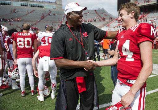 FILE - In this April 15, 2017, file photo, Keyshawn Johnson Sr., left, hugs Nebraska quarterback Tristan Gebbia after the NCAA college football team's spring game in Lincoln, Neb. The increasing visibility of spring football games has offered plenty of feel-good moments and fan-friendly opportunities. What they don't provide is much insight into what these teams will be doing this fall.  (Jake Crandall/The Journal-Star via AP)