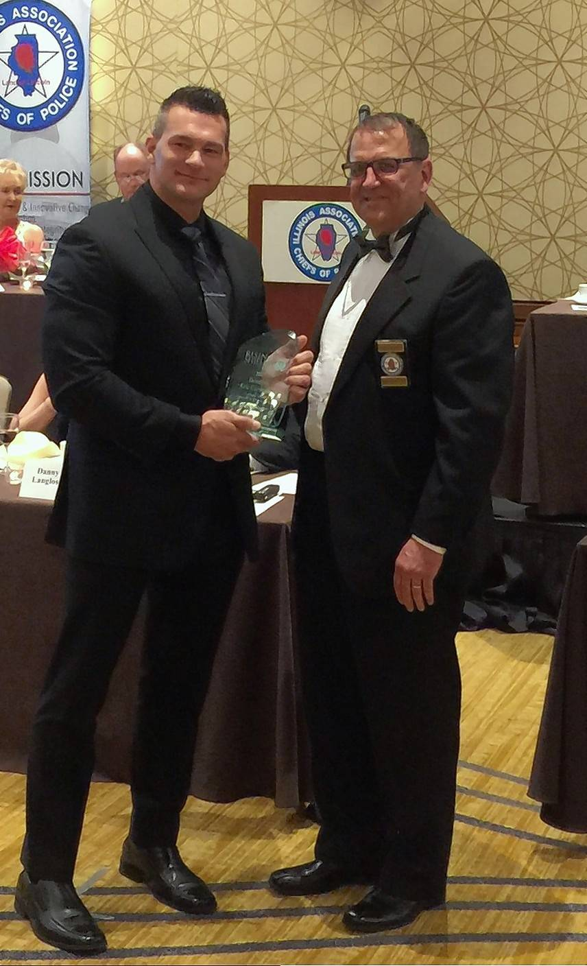 "Lake County sheriff's Detective Eric Carstensen was presented with the ""Rising Shields of Law Enforcement"" by Ed Wojcicki, executive director of the Illinois Association of Chiefs of Police."