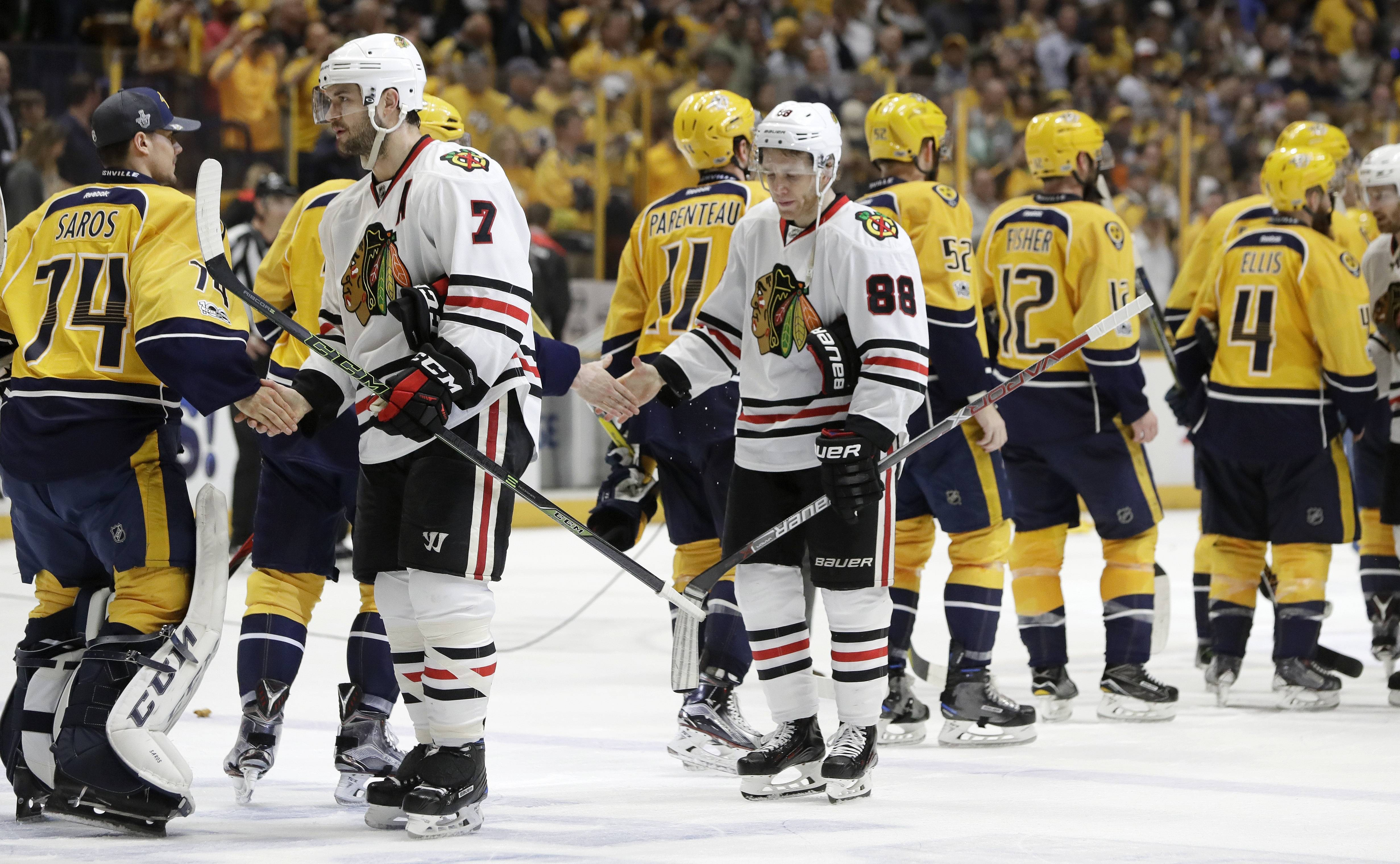 Chicago Blackhawks defenseman Brent Seabrook and right wing Patrick Kane shake hands with Nashville players after the Predators won 4-1 to sweep the first-round series.
