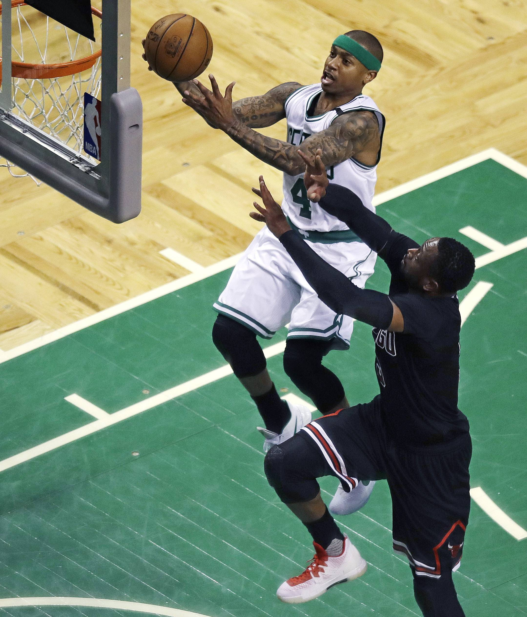 Boston Celtics guard Isaiah Thomas (4) drive to the basket against Chicago Bulls guard Dwyane Wade during the first quarter of a first-round NBA playoff basketball game in Boston, Wednesday, April 26, 2017.