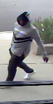 Waukegan police say this is one of three men suspected in the armed robbery Tuesday of a cellphone store.