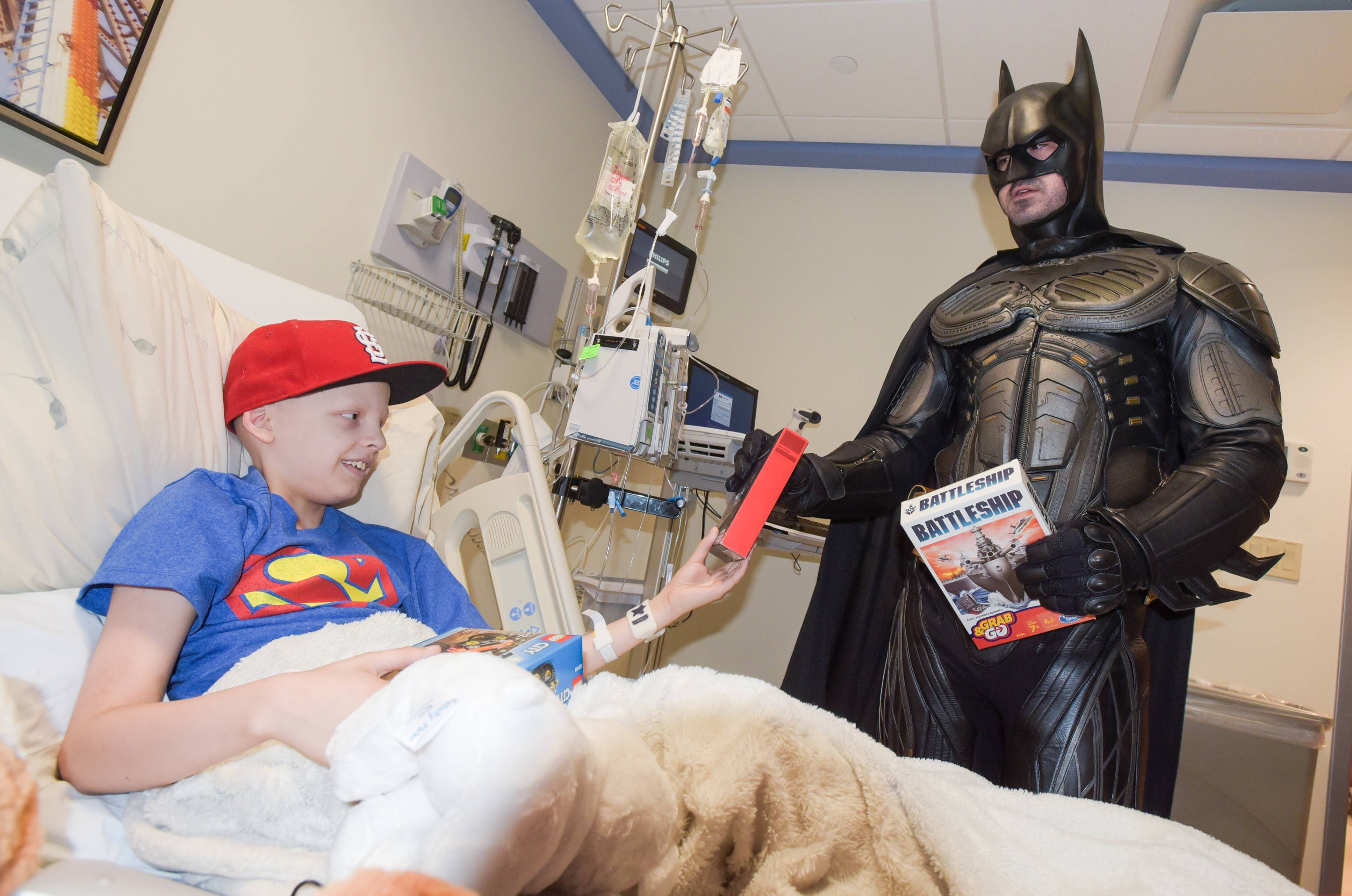 Ty Hawkinson, a 12-year-old from South Elgin with Ewing's sarcoma, gets a visit from Batman at Northwestern Medicine Central DuPage Hospital during Superhero Day.