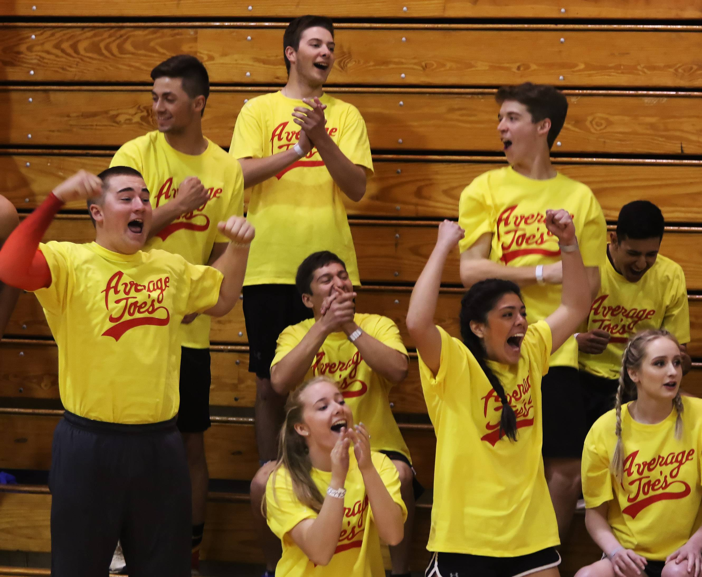 Gilbert R. Boucher II/gboucher@dailyherald.comThe Average Joe's team celebrates as their teammate sinks a basket during Mustang Olympics on Sunday at Mundelein High School. Teams competed in games like dodgeball, hamster ball relay and knock-out.