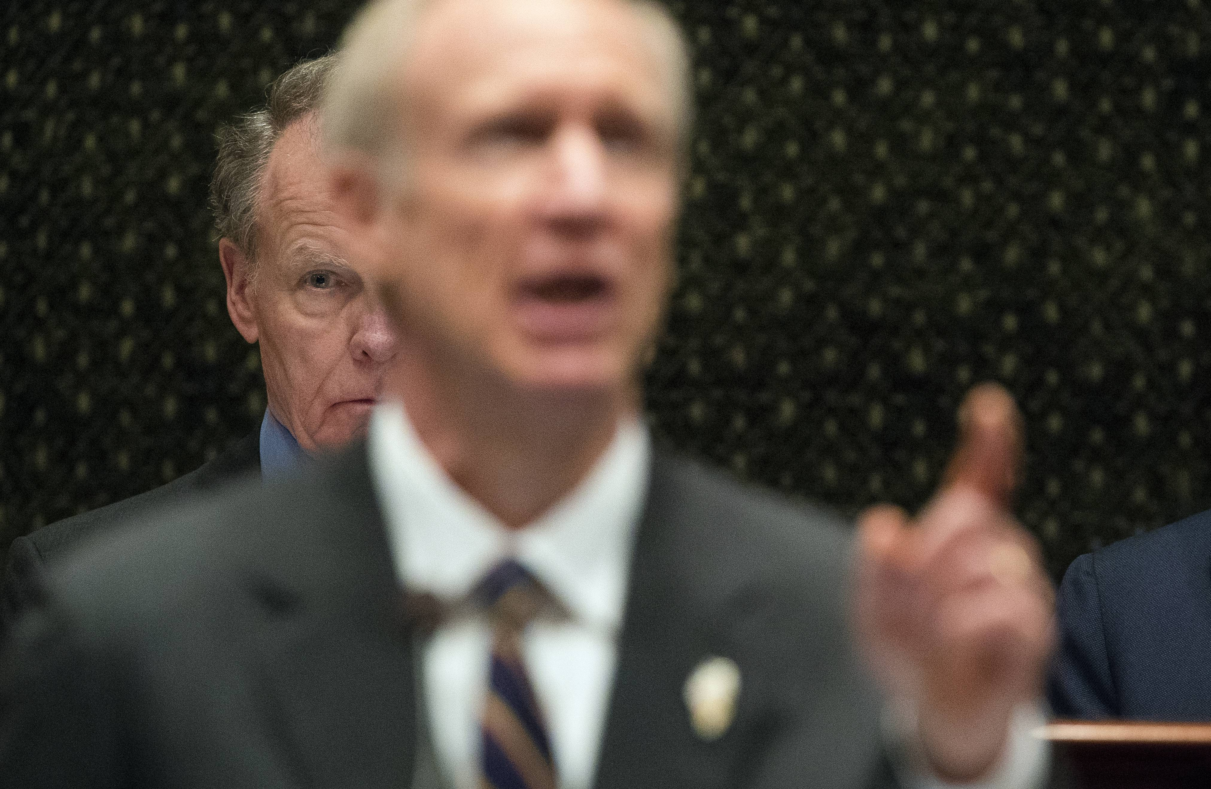 Illinois House Speaker Michael Madigan listens as Gov. Bruce Rauner delivers his State of the State address last January.
