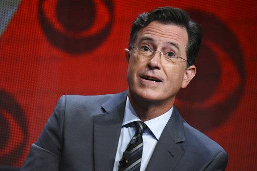 "FILE - In this Aug. 10, 2015, file photo, Stephen Colbert participates in ""The Late Show with Stephen Colbert"" segment of the CBS Summer TCA Tour in Beverly Hills, Calif. Colbert says he has no regrets about insulting President Donald Trump in a monologue that included a crude sexual reference and prompted calls to fire him and boycott ""Late Show� advertisers. In his Wednesday, May 3, 2017, monologue, Colbert says he would change ""a few words that were cruder than they needed to be� but he'd still do it again. (Photo by Richard Shotwell/Invision/AP, File)"