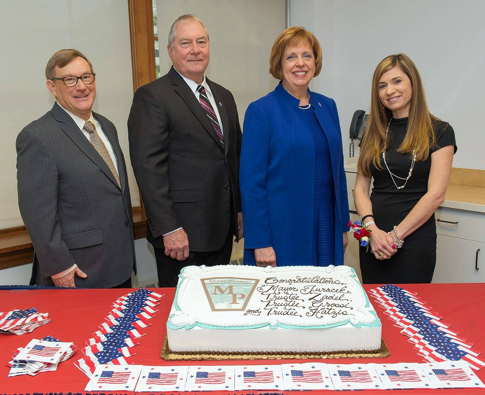 From left, Bill Grossi, Michael Zadel, Arlene Juracek and Eleni Hatzis were sworn in last week after the Mount Prospect village election in April.