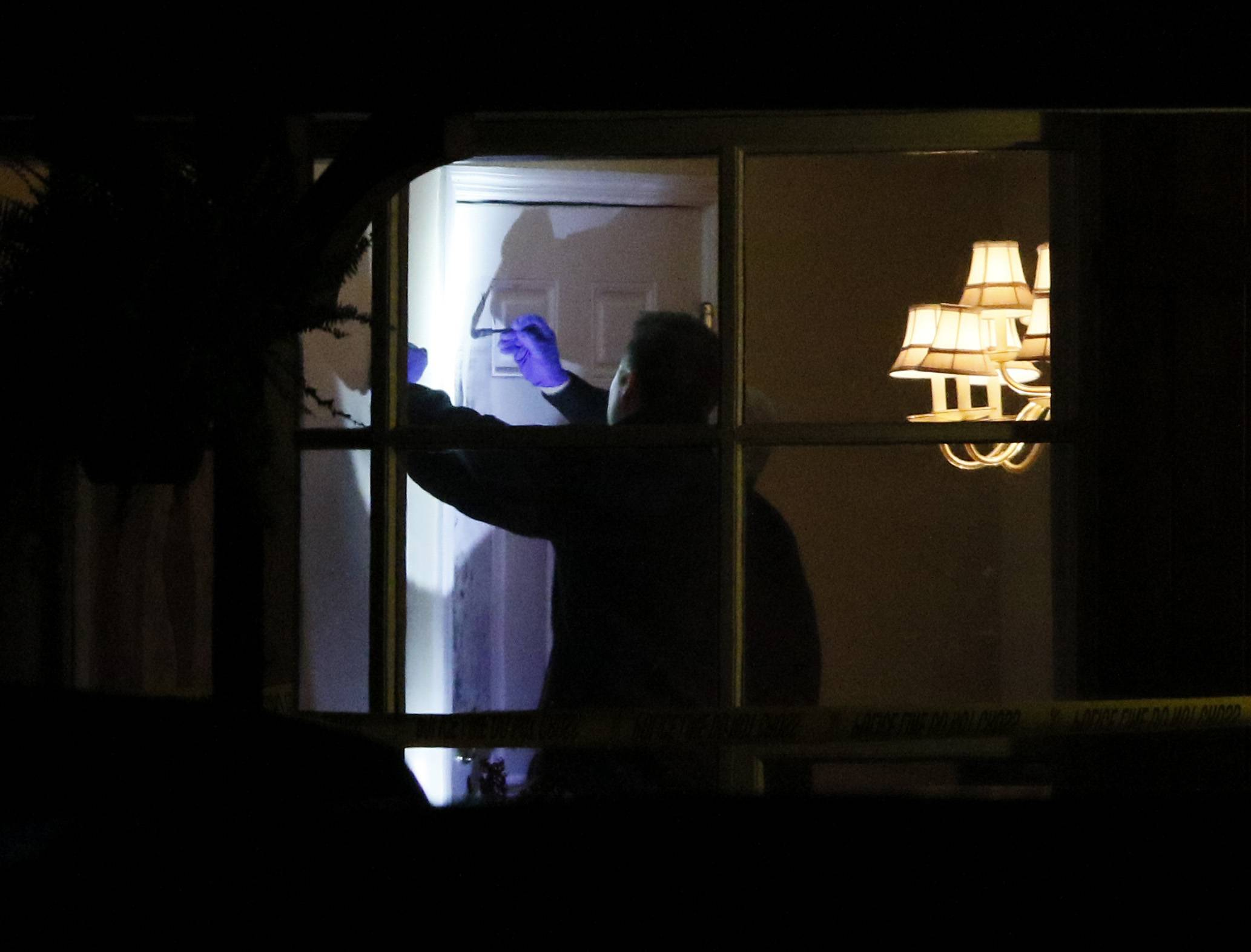 Hinsdale Police gather evidence in a home on the west side of town across from the train station where a 50-year-old woman identified as Andrea Urban was killed.